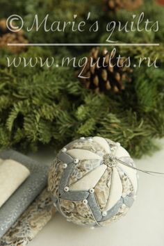 This ornament 3 inches in diameter is made of Christmas fabric. To made it, I used kimekomi technique . This is of my own design and your