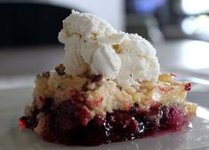 Hubby's Favorite Dump Cake - Made with five simple ingredients including a box of yellow cake mix, a can of crushed pineapple and a can of cherry pie filling, this recipe for Hubby's Favorite Dump Cake is as traditional as dump cake recipes come. It has all the great tropical flavor that you'd expect, plus so much more!