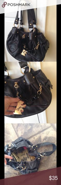 JUICY COUTURE PURSE Juicy couture purse in great condition. Magnetic snap closure with pretty charms. Juicy Couture Bags Shoulder Bags