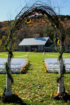 Sunflower wedding arch, I like the idea of adding a pop of color with sunflowers!:) I am from the Sunflower state!:)