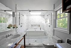 """House Tour and Interview With Interior Designer Kriste Michelini: CS: I recently heard someone describe the style of joint bath/shower you have as """"a party shower."""" Ha! I've only seen this layout a couple of times before . . . do you think it's sort of an up-and-coming style?KM: I think wet rooms have become more popular as clients are trying to create a spa feeling at home. I love the tub and shower combined. When the kids were little, it was an efficient way to get them cleaned all at…"""