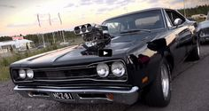See couple of super clean Mopars showing off the power of American muscle during a drag racing event in Finland!