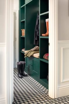 The dark green entryway cabinetry provides a classic look for this traditional upscale home