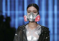 A model wearing a mask presents a creation at the QIAODAN Yin Peng Sports Wear Collection show during China Fashion Week in Beijing, October 28, 2014. (Reuters/Stringer)