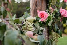 Apples and roses cover an old barn wood arbor | Tin Roof Barn, weddings and events in the Pacific Northwest