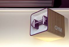 The cube icon from the original logo was re-instated within 3D signage (a subtle reminder of the room aesthetic) while graphics were kept to a minimum and echo the clean, futuristic lines and modern materials of the interiors