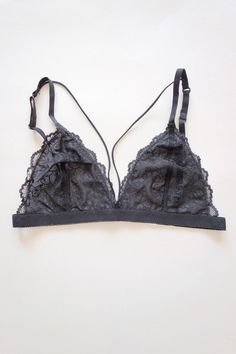 5555b80bffa5d This stretchy bralette features triangle-shaped bust panels composed of  sheer floral lace connected to