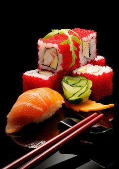 SUSHI~ 5 sheets nori, 2 cups sushi rice, 2 oz sushi-grade tuna cut into ¼ by ½ by 3-inch strips, 2 oz sushi-grade salmon cut into ¼ by ½ by 3-inch strips, 1 hot house cucumber julienne, 1 carrot peeled and julienne, ½ avocado thinly sliced.