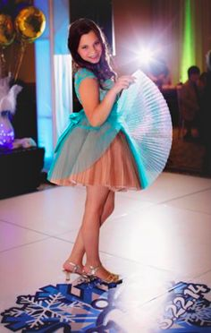 A short turquoise dress from It's Simply For You boutique for a Bat Mitzvah girl who celebrated in Vermont with a Winter Wonderland theme.