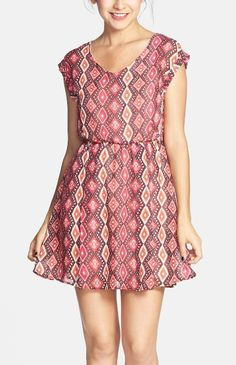 So many colors! Loving the print of this skater dress.