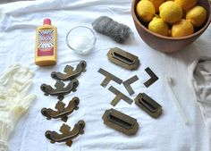 Brass Hardware Polishing: Brasso or Use a mixture of salt and lemon juice as a natural polish, ¼ cup of salt per  ½ lemon to make a paste. Soak 20 mins. Either one works great on either brass plate or real brass, just be sure to use a soft rag or soft toothbrush.  Lemon juice is acidic, so be sure to fully rinse. Using a little olive oil on top will prolong the periods between polishing.