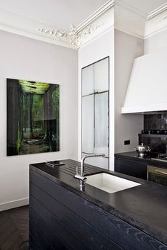 This quintessential Parisian apartment with Haussmann details is furnished with wonderful furniture from diverse periods.