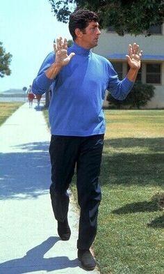 """Don't shoot"" - Dean as Matt Helm taking refuge from ""The Ambushers"" (1967 )."