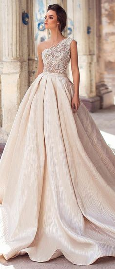 One-shoulder pearl and sequin beaded dress with voluminous pleated skirt and royal train is full of romance #weddingdress #weddinggown #bridalgown