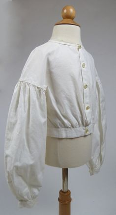 Lovely Antique White Cotton Bodice with Button Closure from the Mid 19th Century   eBay - this is what a white bodice looks like, folks...it is NOT a blouse that tucks into a prairie skirt