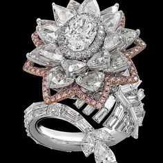 thejewellclosetStunning exquisite diamond ring. This ring comprises of white and…