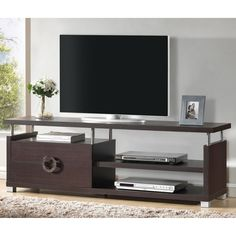 Ideal for any wall in any space, this versatile Burdin TV Stand is a marvel of what superior function and style can do together. Two drawers paired with open shelving and top surface space give plenty of options.