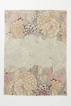 Mutabilis Rug  Lush wool-crewelwork hibiscuses shift hues across the floor, from saturated fuchsia, brown and burgundy to spectral grey.  For best results, use with a rug pad  Wool; cotton backing