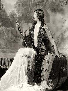 Ziegfeld Girls this robe with a flesh colored top that has a neckline that plunges to my navel and no bra