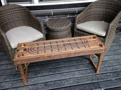 Large Cribbage Board; Great addition to the deck, cabin, or out camping. Solid wood construction with dark walnut stain and finish. This table stands 20 tall, 44 Long, and 14.5 Wide. Comes with 4 drink holders, large playing pegs, card storage, and folding lockable legs for easy