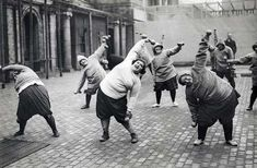 Gymnastics, lose weight. Group women undergoing slimming course in a courtyard in New York, 1920s.