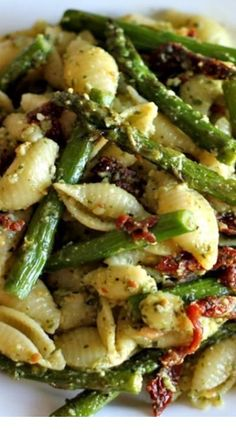 Pesto Pasta With Sun Dried Tomatoes And Roasted Asparagus - A quick and easy dish for those busy weeknights, and it is chockfull of veggies!  == CLICK THROUGH TO SEE! == | Vegetarian | Vegetarian Recipes | Vegetarian Meals  | Vegetarian Recipes Dinner | Vegetarian Meal Prep | Vegetarian Dinner | Vegetarian Recipes Healthy | Vegetarian Recipes Easy | Vegetarian Recipes High Protein  | #tulul