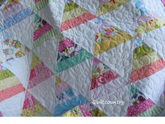 Handmade scrap quilt, baby girl quilt, couch throw, lap quilt, modern quilt, nursery decor, crib quilt. $125.00, via Etsy.