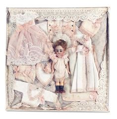 In a Perfect World: 39 German Bisque Miniature Doll in Trousseau Presentation for the French Market