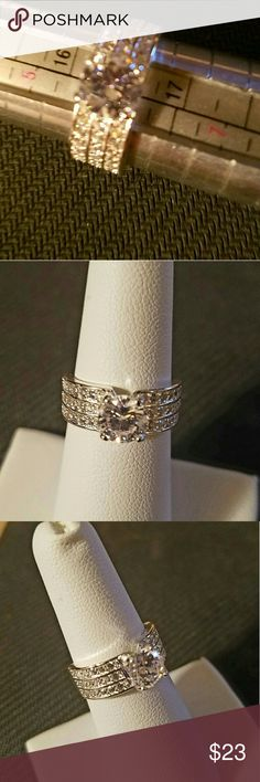 Just in! Insanely Gorgeous Engagement Ring PLEASE LET ME KNOW WHAT SIZE YOU NEED BEFORE YOU ORDER, SO I CAN MAKE SURE THAT I HAVE IT AND I'LL CREATE YOU A SEPERATE POST.  THANKS! Sterling Silver stamped Engagement/Wedding Ring. Size 6, 7, 8, 8.5, 9, 10. Great quality, looks real! 1 ct center. Channel set czs on both sides. You will love this ring!! New, never worn.  Box in picture is for display purposes only.  I tried to show the sterling silver 925 stamp in the last picture.  Free gift…