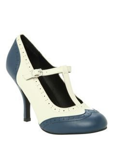 Add a bit of old school to your style with these Bombshell heels. Vintage brogue style design. T-bar buckle up strap.
