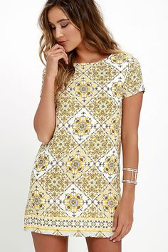 Make a fierce fashion statement in the Dandy Lion Yellow Print Shift Dress! Short sleeves and a rounded neckline flow into a woven shift dress with a beige, taupe, and yellow tiled print. Exposed silver back zipper.