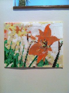 """Spring Flowers Large Perler Pixelated Hanging Wall Art by SweetLolitas. Featuring a bright orange hibiscus flower among a backdrop of mixed spring flowers. This piece measures 16"""" by 12"""" and is made from over 5000 beads."""