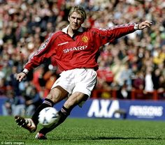 David Beckham takes one of his trademark free-kicks during his playing days with Mancheste...