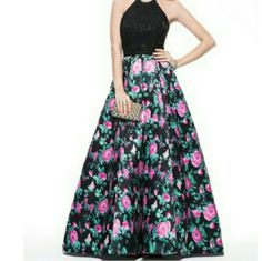 Black and Floral Gorgeous Dress This beautiful floor length dress features an A Line silhouette with a halter top. It zips up from the back and has a built in bra, is fully lined and has boning for support. This dress comes in the following US sizes : 2,4,6,8,10,12,14 and 16.   Please inquire about sizes to ensure that the measurements of your bust, hips, and waist match the size desired :). Also, please order 8-12 weeks before your event date to make sure your dress comes in on time! Gowns…