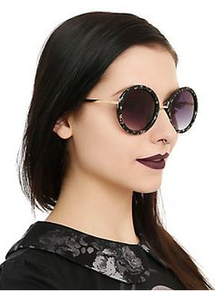 $10.00 Round frame sunglasses with a floral print.