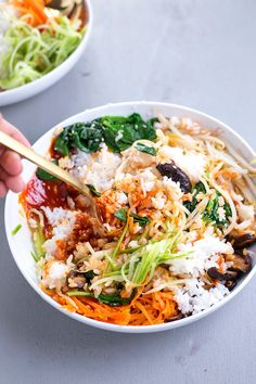 Vegan Korean Bibimbap - a classic Korean dish of rice and seasonal sauteed vegetables, served with a spicy Gochujang chilli sauce.