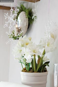 Jill Sharp Brinson's 1930's Cottage: Glitter-dusted snowflakes, also from Kasler's collection, sparkle above potted paper whites for a chic white Christmas moment.