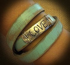 Leather Cuff with Stamped Metal Work by BellaDoniBoutique on Etsy, $25.00