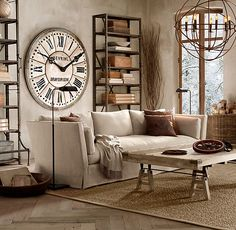 I like some of the elements in this room, especially the rustic industrial shelving in the background, the coffee table, and the giant clock. -A