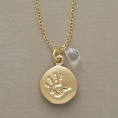 PERSONALLY YOURS BIRTHSTONE HANDPRINT NECKLACE -- Perfect for Mom. Our exclusive handprint necklace becomes a meaningful keepsake with the added personal touch of a birthstone briolette (all 12 birthstones available). Perfect for celebrating a baby's arrival or marking the birthday of a child or grandchild. Charm and chain are 18kt vermeil
