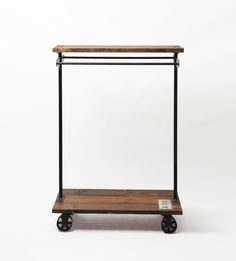 A designer garment Rack that is extremely useful in a home and gorgeous too.  What a great piece and it rolls.