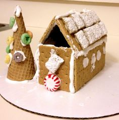 A gingerbread house and a waffle cone Christmas tree made by Elli, 3 years old • Art My Kid Made Artist of the day on Dec. 17, 2012 #kidart #Christmas #holidayart #foodart