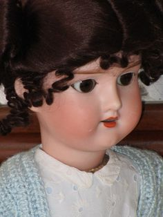 Antique bisque (porcelain) doll in impeccable condition with an antique composition body. The mohair wig. The original eyes are glass and pendulous.It measures about 48 cm.  On the back of the head it has a mark Made in Germany No. 390 A. 5. M.