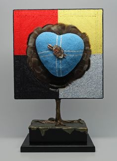 """The Warriors Heart. Mixed media on wood, 2-sided,12"""" tall x 8 1/4"""" wide x 4 1/2"""" deep."""