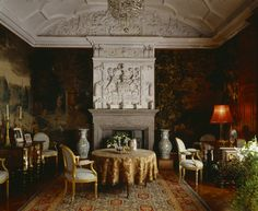 Looking towards the plasterwork overmantel, in the Morning Room at Lanhydrock, flanked by 17th century tapestries, one English and the other Flemish and two 18th century jars