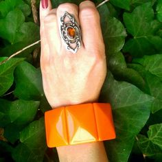 """Vintage Orange Bakelite Stretch Bracelet Rare and Fun Vintage Orange Bakelite Stretch Bracelet. Panels are faceted, and measure approximately 1.5"""" x 1.2"""". Will stretch to fit most wrists. Excellent vintage condition with minimal wear. Vintage Jewelry Bracelets"""