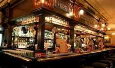 'valance' above counter top. sometimes with classes hanging from above. English Pub - Yahoo Image Search Results