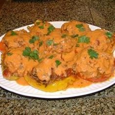 A very delicious stuffed pepper recipe with a yummy creamy tomato sauce.
