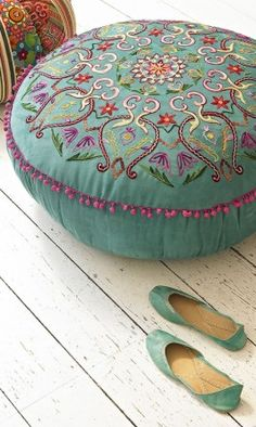 "Now these are called ""poufs""?? I thought they were hassocks, but maybe they are two different things. ""Poufs"" sounds so, well, unsophisticated.  Anyway… I think this is beautiful, and yes, I have wanted to paint my beautiful old wood floors white for a long time, too. ::gasp!::"