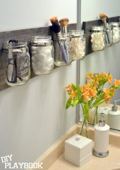 20 Bathroom Organization Ideas via a Blissful Nest, DIY Mason Jar Organization by DIY Playbook Pot Mason Diy, Mason Jar Crafts, Pots Mason, Mason Jar Shelf, Diy Mason Jar Lights, Hanging Mason Jars, Diy Projects With Mason Jars, Plants In Mason Jars, Mason Jar Organizer